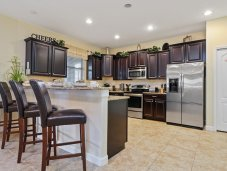 Fully equipped kitchen with barstools