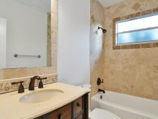 Bathroom with shell stone and  tumbled marbles