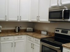 Fully equipped kitchen in Caribe Cove condo
